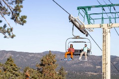 snowboarders on a chairlift