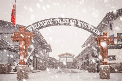 bear mountain welcome sign with snowfall