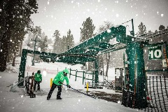 bbmr staff shoveling snow near chairlift
