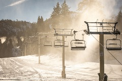 snowmaking guns are on, chairlifts, snowy hills at snow summit