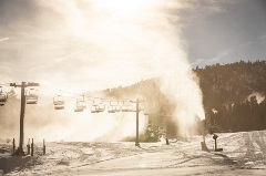 snowmaking guns are on, snowy hills at snow summit