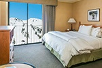 Hotel room with king bed and snowy mountain view